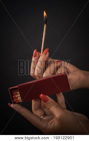 Woman Hands Ignite Big Matches For A Cigar Or Fireplace