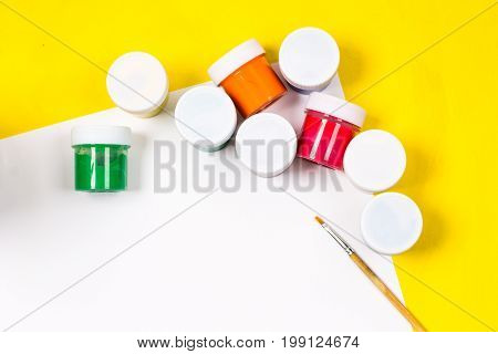 School Supplies And White Sheet On A Bright Yellow Background, Ready For Your Design