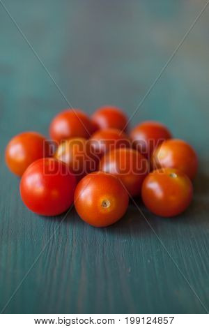 Fresh tomatoes texture and background. Tomato texture. Red tomatoes. Healthy food. Close up view of tomatoes on wooden background. Abstract background and texture for designers. Fresh food texture.