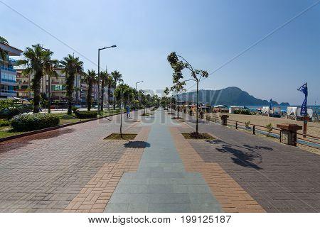 ALANYA TURKEY - JULY 09 2015: Embankment near the beach. Alanya - a popular holiday destination for European tourists.