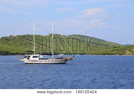 ISLAND DUGI OTOK, CROATIA - SEPTEMBER 7, 2016: This is pleasure boat off the Dugi Otok Island where is located the Telascica National Park.