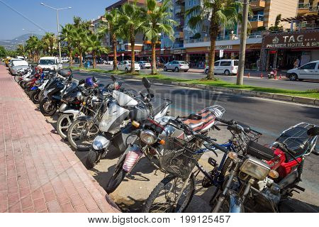 ALANYA TURKEY - JULY 09 2015: Parking of motorcycles on the central avenue of the city. Alanya - a popular holiday destination for European tourists.