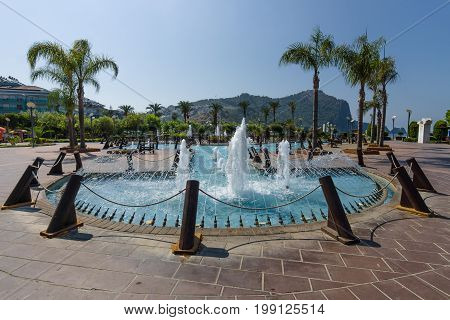 ALANYA TURKEY - JULY 09 2015: Embankment near the public beach in the central part of the city. Alanya - a popular holiday destination for European tourists.