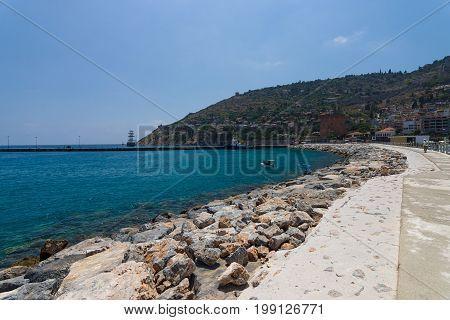ALANYA TURKEY - JULY 09 2015: The coastline near the sea port of Alanya. Alanya - a popular holiday destination for European tourists.