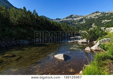 Amazing landscape of Mountain river and Banderishki Chukar peak, Pirin Mountain, Bulgaria