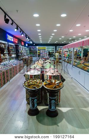 KONAKLI TURKEY - JULY 10 2015: Trade in traditional oriental spices in one of shops large and popular among tourists shopping center on the Anatolian coast near the town of Alanya.
