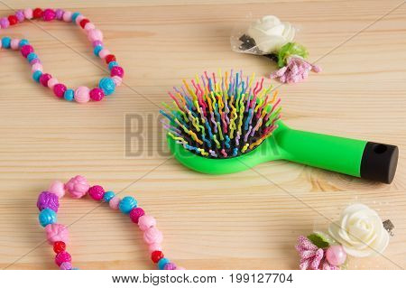 Colorful Hair Comb Crest Brushes With Handle, Bright Beads On Woden Background. Mininmalistic Femini