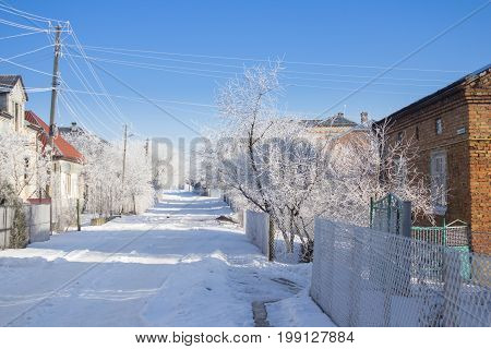 Village street of the winter morning of frosty beauty