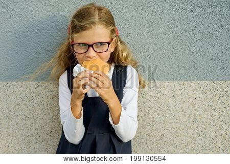 Happy school child with lunch. Back to school outdoor