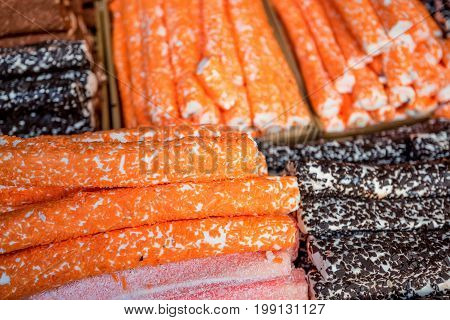 Close up tasty dessert nougat on market counter