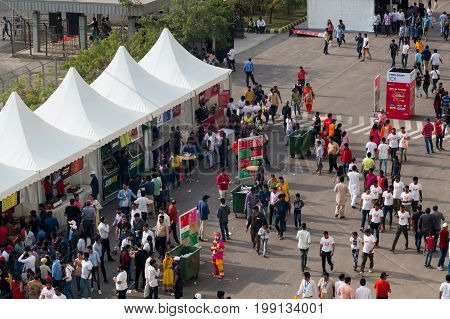 Delhi, India - 19th Mar 2017: Indian crowd gathering around food tents to enjoy the delicacies