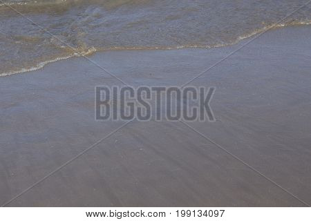 Sand On Beach By Ocean