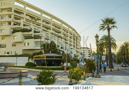 Evening view with an exotic street near the Puerto Banus in Marbella city on September 20 2016 in Andalucia Spain. Marbella is a city and municipality in southern Spain belonging to the province of Málaga in the autonomous community of Andalusia.
