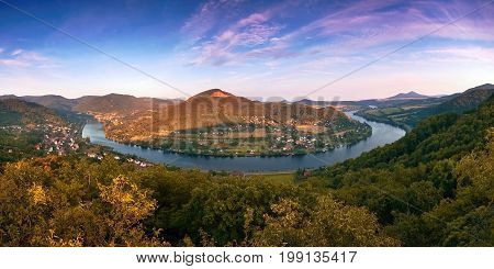 Meander named Porta Bohemica in valley of european river Elbe when viewes from Mlynaruv kamen lookout in czech central mountains tourist area at sommer sunset