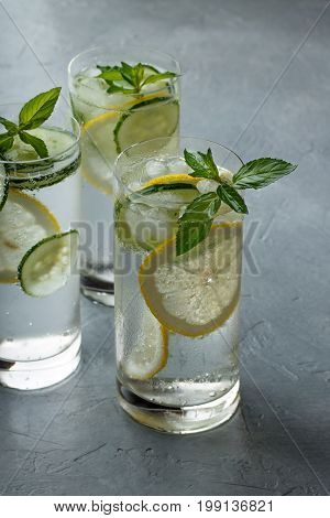 Refreshing Non-alcoholic Cocktail With Lemon, Cucumber And Mint On Gray Background.
