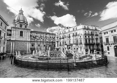 Palermo, Sicily, Italy. In the heart of Palermo's loveliest square, Piazza Pretoria, stands magnificent fountain, Fontana Pretoria, work of Florentine sculptor Francesco Camilliani. Black and white.