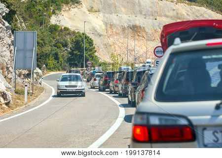 NEUM BOSNIA AND HERZEGOVINA - JULY 16 2017 : Cars waiting in line towards the border between BIH and Croatia in Neum Bosnia and Herzegovina.