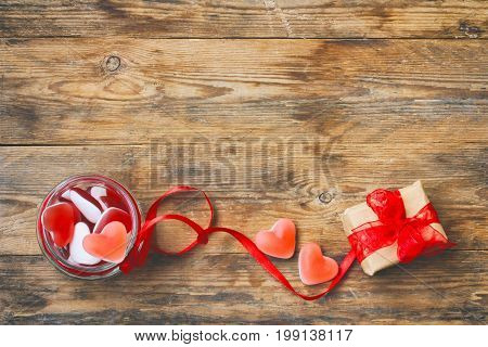 Red marmalade candy shape heart in glass jar with ribbon gift box for Valentine's Day retro style