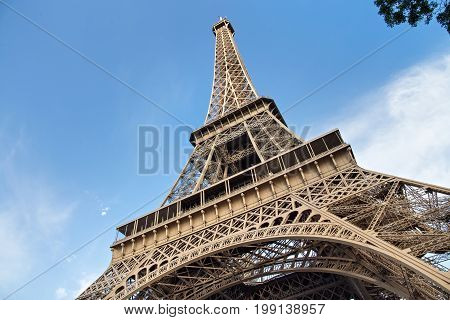 View of the Eiffel Tower in Paris. France. The Eiffel Tower was constructed from 1887-1889 as the entrance to the 1889 World's Fair by engineer Gustave Eiffel.