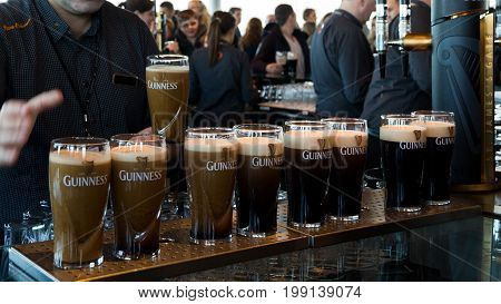 DUBLIN IRELAND - FEB 15 2014: Pints of beer are served at the Guinness Brewery. The brewery where 2.5 million pints of stout are brewed daily was founded by Arthur Guinness in 1759.