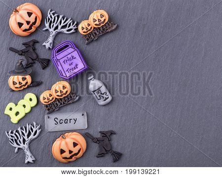 Decorative halloween objects on a textured gray surface