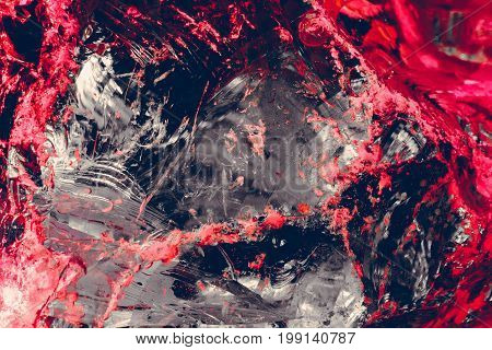 glass chips of gray color with splashes of bright red and pink color, broken, large texture, red chaotic stripes and spots, background image,
