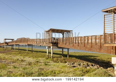 Wooden walkway at the riverbank of Rio Tinto river in Huelva Andalusia Spain