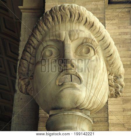 Antic drama roman mask, Rome, Italy. Square toned image