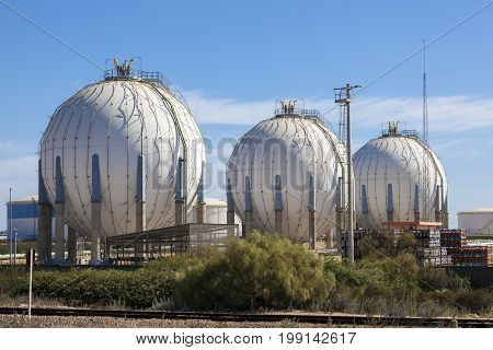 Spherical gas tanks at an industrial refinery