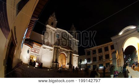 Quito, Pichincha / Ecuador - August 9 2017: Night view of tourists entering the museum inside the Church of El Carmen Alto located in the historic center of the city of Quito