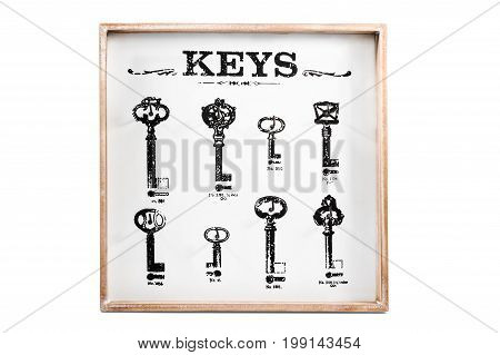Wooden frame with a pattern for storing keys on hooks isolated on a white background