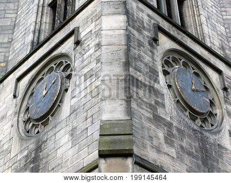 the tower of church of saint johns in leeds a seventeenth century church showing two old clocks