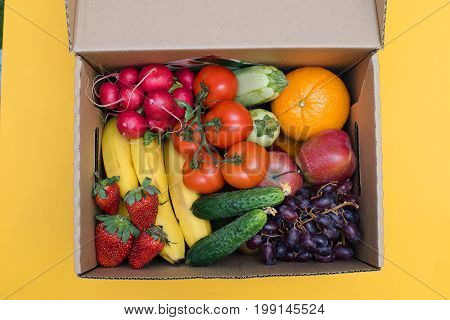 Fresh Vegetables in wooden box on white wooden background