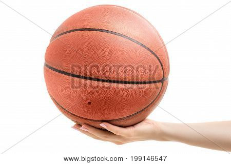 Basketball in a female hand on a white background isolation
