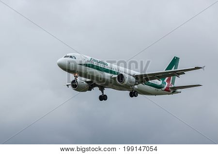 London UK - August 8 2017: Plane Airbus A320 Alitalia Airlines landing at London Heathrow Airport