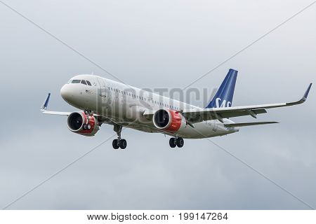 London UK - August 8 2017: Airbus A320 Scandinavian SAS airlines landing at London Heathrow airport