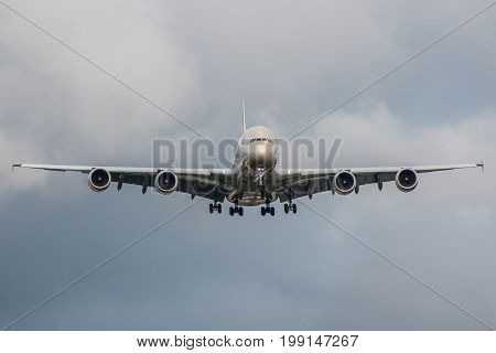 Large passenger plane landing on the airport during stormy weather