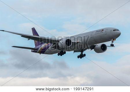 London UK - August 8 2017:Boeint 777 Thai airlines landing at London Heathrow airport