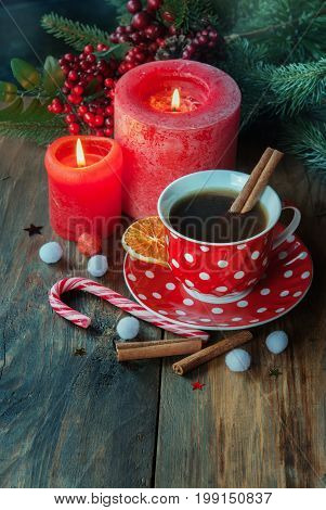 Christmas cup of tea with spice orange and Christmas decor on the wodden table