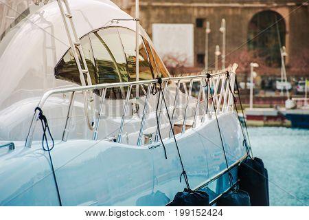 Modern Luxury Yacht Sailing. Vessel in the Marina Closeup Photo.