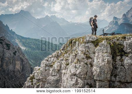Mountain Biker in the Italian Dolomites. Scenic Bike Ride Near Misurina Italy. Italian Alps.