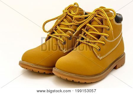 A pair of brand new boy's high ankle shoes on white background.