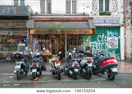 Motor cycles lined up outside a shop in A2 Paris 16th May 2017