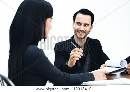 Manager businessman and assistant Secretary in his office. The Secretary brought the boss documents to sign during meeting.