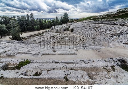 Panoramic view and detail of the ancient and historic roman amphitheater of syracuse on the island of sicily italy