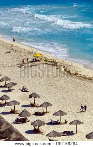 CANCUN MEXICO - MARCH 10: Tourists on a beach in Cancun Mexico on March 10 2017