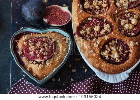 Cake with baked figs pastry with almond paste flavored with honey sprinkled granola with nuts