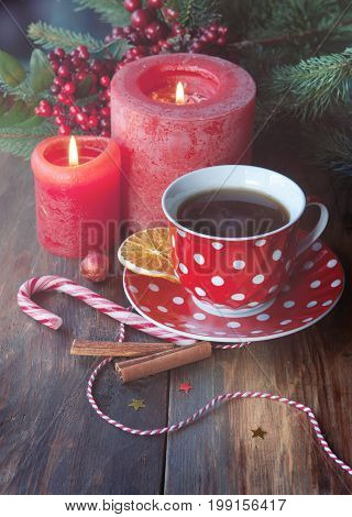 Christmas cup of tea with spice orange and candles