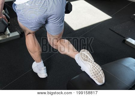 Woman With Dumbbells Exercising Hamstrings