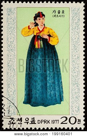 Moscow Russia - August 09 2017: A stamp printed in DPRK (North Korea) shows a woman in traditional Korean dress for autumn series